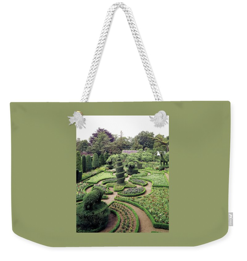 Exterior Weekender Tote Bag featuring the photograph An Ornamental Garden by Tom Leonard