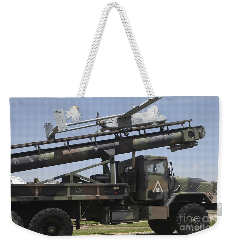 Horizontal Weekender Tote Bag featuring the photograph An Rq-2b Pioneer Uav On An M927 by Timm Ziegenthaler