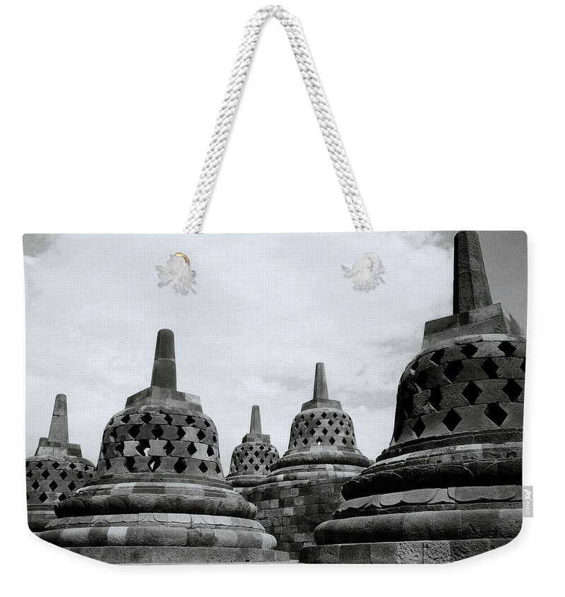 Borobudur Weekender Tote Bag featuring the photograph Ancient Borobudur Stupas by Shaun Higson