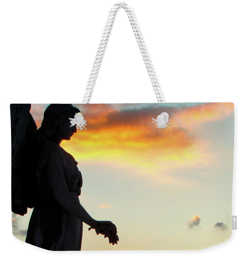 Silhouette Weekender Tote Bag featuring the photograph Angel Silhouette In Burst Of Colors by Gothicrow Images