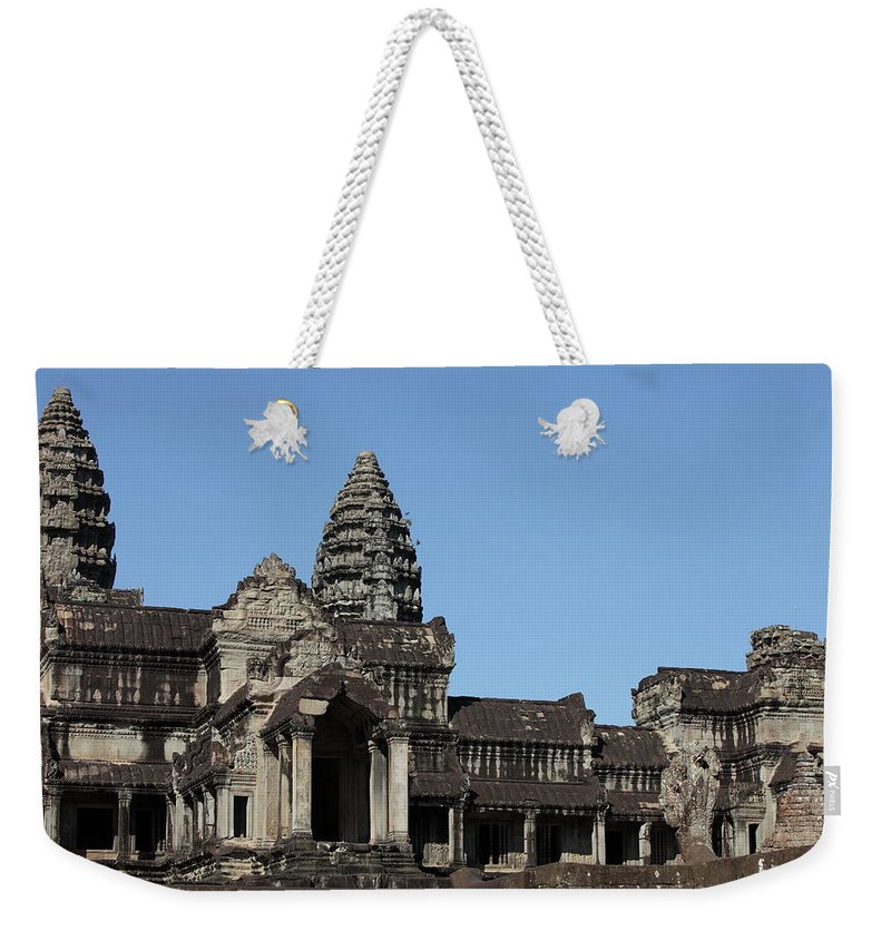Southeast Asia Weekender Tote Bag featuring the photograph Angkor Wat Temple, Cambodia by Laurent