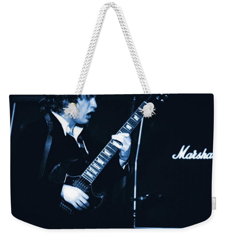 Angus Young Weekender Tote Bag featuring the photograph Angus Chords Delight Crowds In Blue by Ben Upham