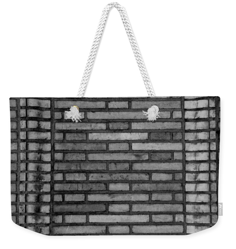 Scenic Weekender Tote Bag featuring the photograph Another Brick In The Wall In Black And White by Rob Hans