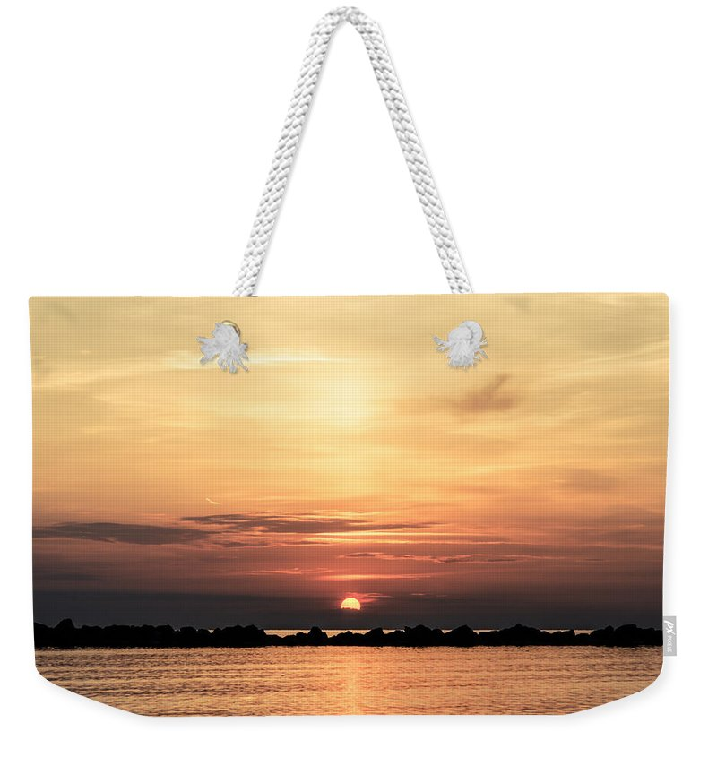 Staring At The Sun Weekender Tote Bag featuring the photograph Another Earth - Sunrise On The Sea by Andrea Mazzocchetti