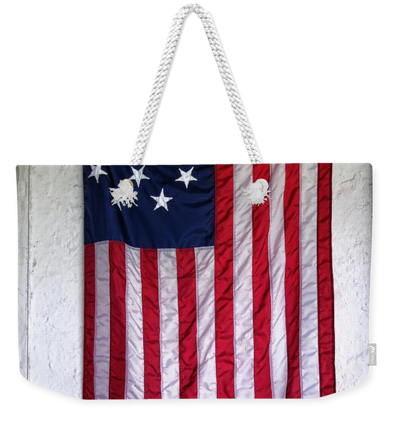 American Weekender Tote Bag featuring the photograph Antique American Flag by Olivier Le Queinec