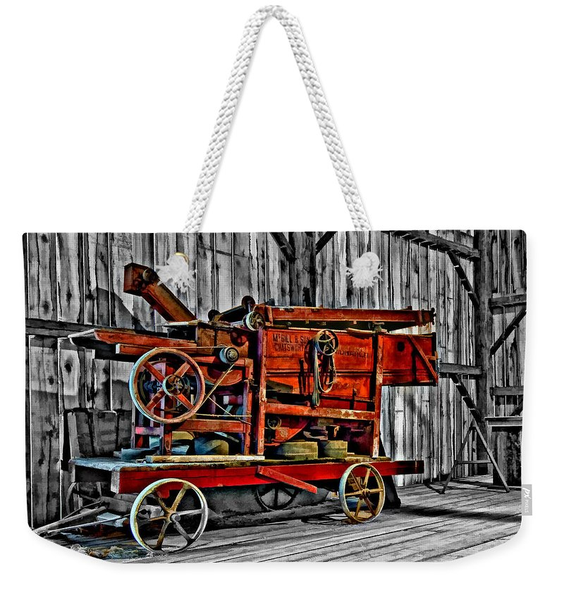 Monochrome Weekender Tote Bag featuring the photograph Antique Hay Baler Selective Color by Steve Harrington