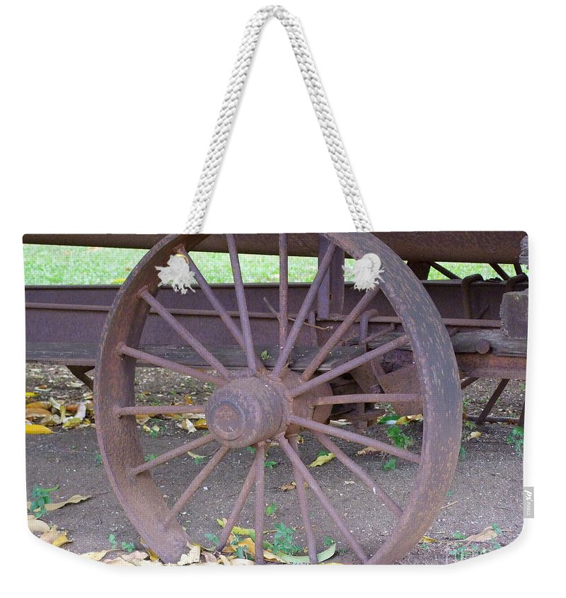Wheel Weekender Tote Bag featuring the photograph Antique Metal Wheel by Mary Deal