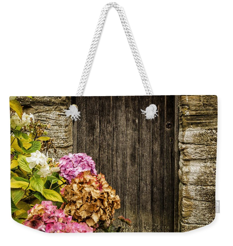 Wooden Weekender Tote Bag featuring the photograph Antique Wooden Door And Hortensia by Dutourdumonde Photography