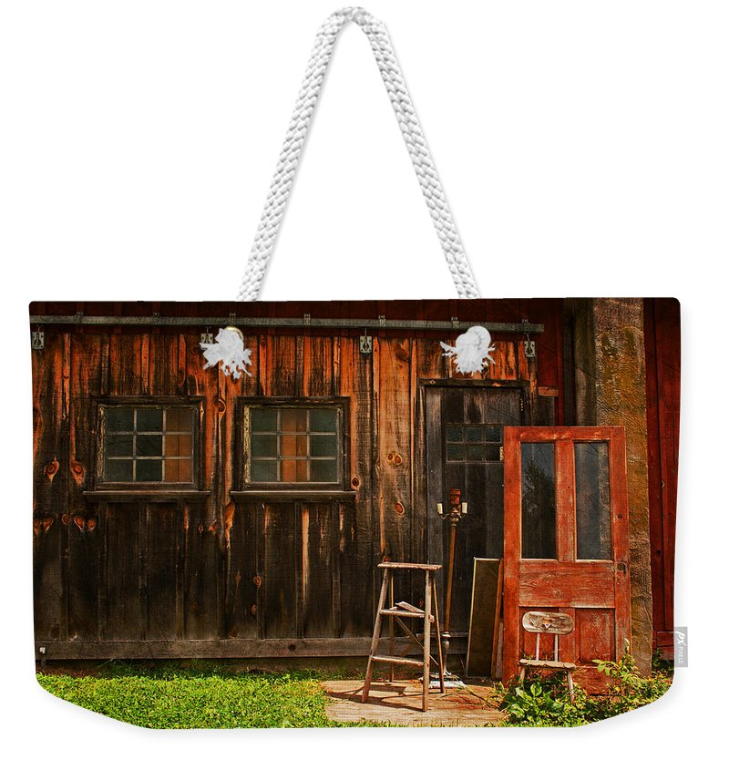 Antiques Weekender Tote Bag featuring the photograph Antiques by Michael Porchik