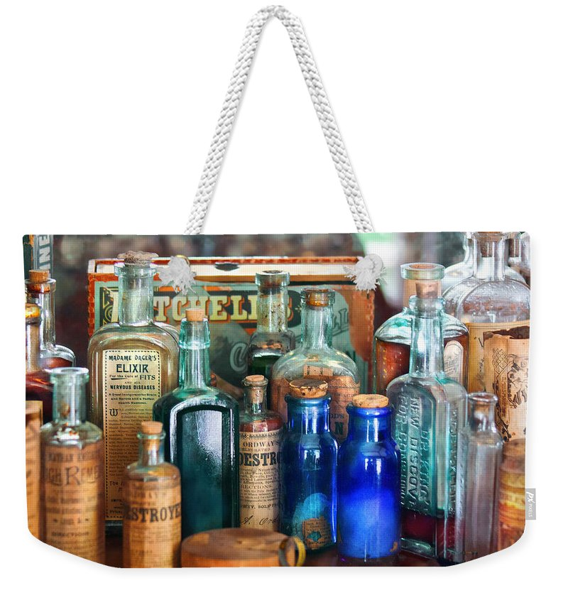 Pharmacy Weekender Tote Bag featuring the photograph Apothecary - Remedies For The Fits by Mike Savad