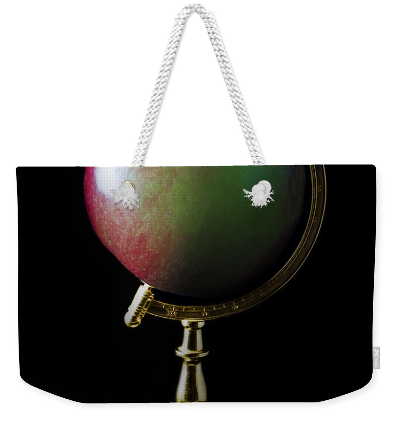 Apple Weekender Tote Bag featuring the photograph Apple Globe by Hal Halli