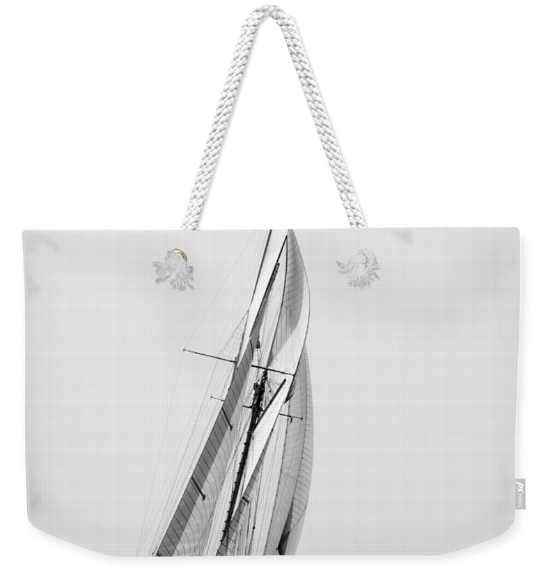 Outdoor Weekender Tote Bag featuring the photograph A Tall Ship In Mediterranean Water Approaching To Lighthouse Of Isla Del Aire - Menorca by Pedro Cardona Llambias