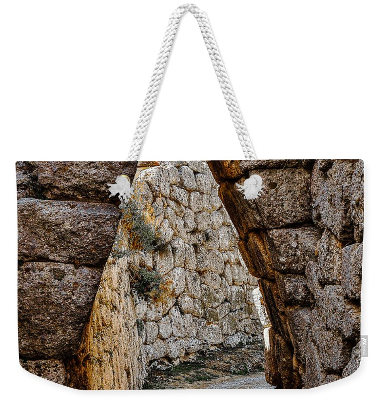 Medieval Weekender Tote Bag featuring the photograph Arched Medieval Gate by Dany Lison