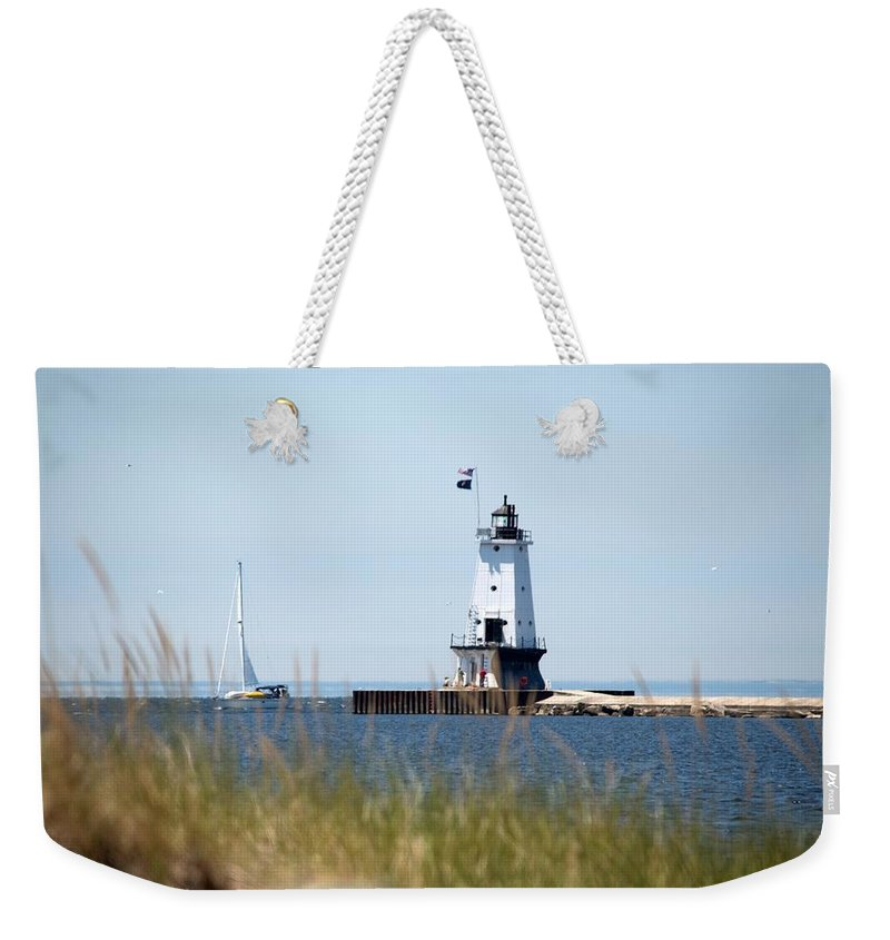 Ludington Weekender Tote Bag featuring the photograph Around The Lighthouse by Linda Kerkau