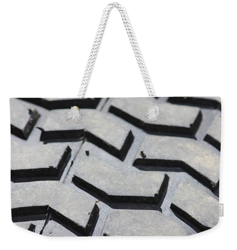Wheel Weekender Tote Bag featuring the photograph Around by Tiffany Erdman