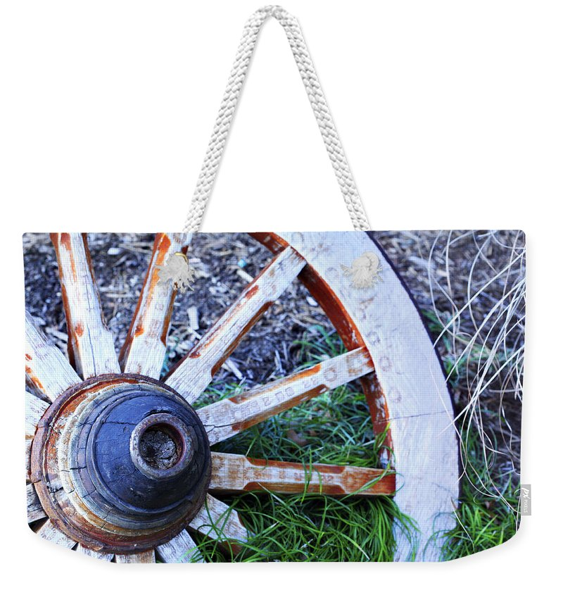 Americana Weekender Tote Bag featuring the photograph Artful Wagon Wheel by Marilyn Hunt