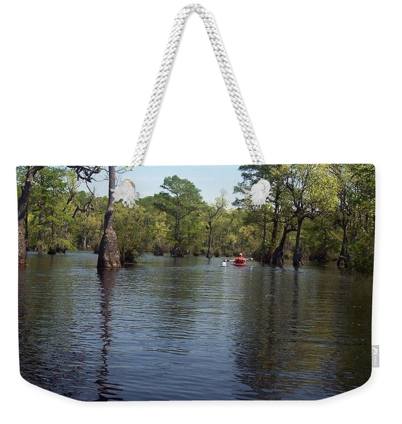 Merchants Millpond Weekender Tote Bag featuring the photograph At The End Of The Canoe by Sandra Clark