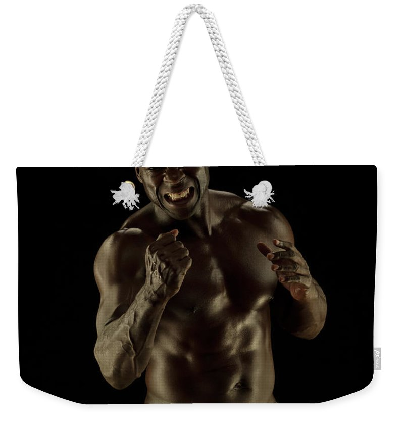 Toughness Weekender Tote Bag featuring the photograph Athletic Female, Angry Shout, Clenched by Jonathan Knowles