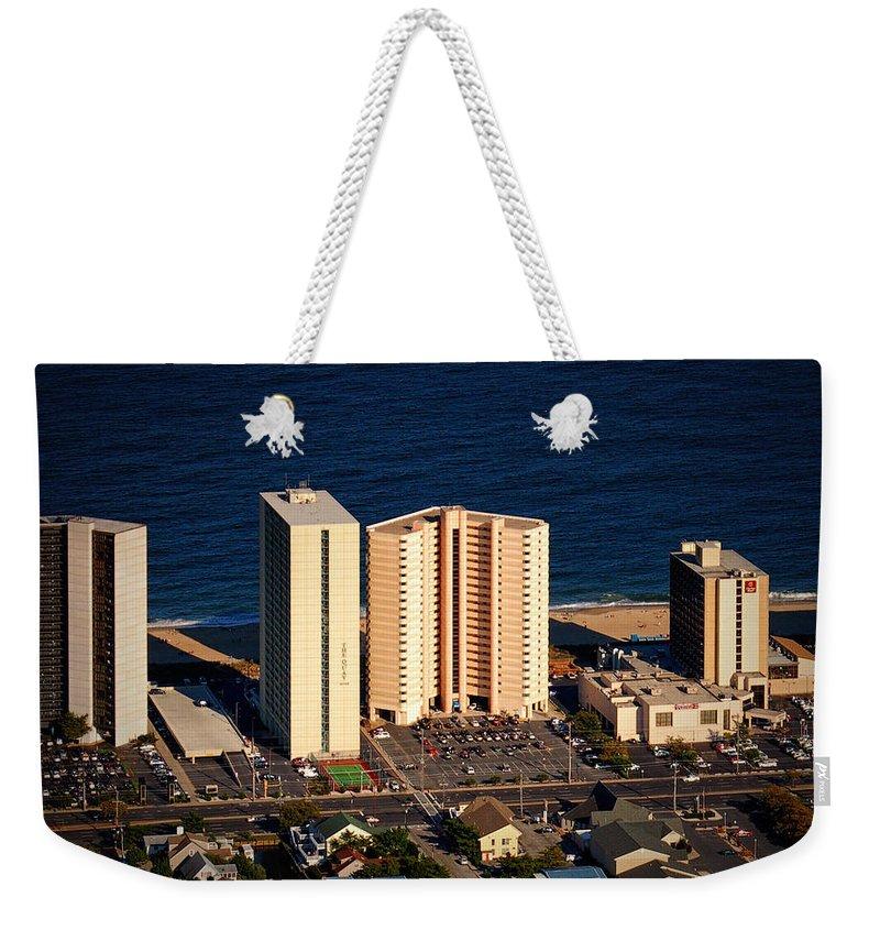 Atlantis Weekender Tote Bag featuring the photograph Atlantis Condominium Ocean City Md by Bill Swartwout Fine Art Photography