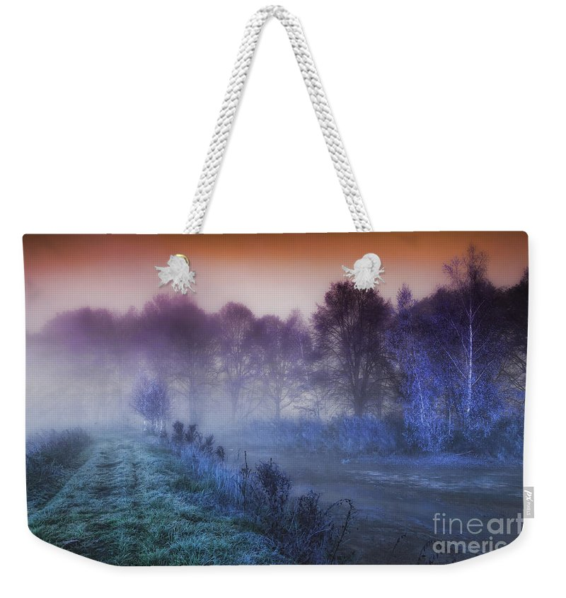 Aurora Weekender Tote Bag featuring the photograph Aurora by Mo T