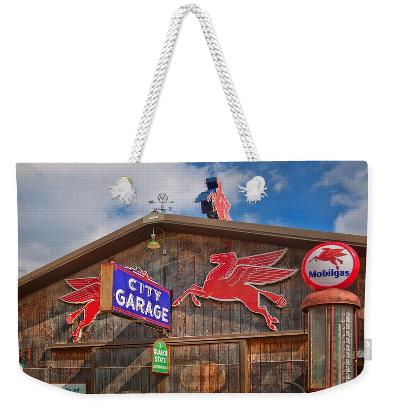 Advertising Weekender Tote Bag featuring the photograph Auto Repair At The City Garage by David and Carol Kelly