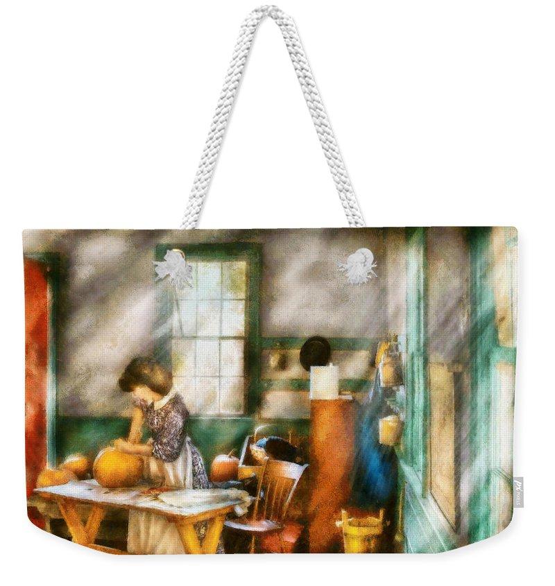 Savad Weekender Tote Bag featuring the digital art Autumn - Halloween - Carving A Pumpkin by Mike Savad