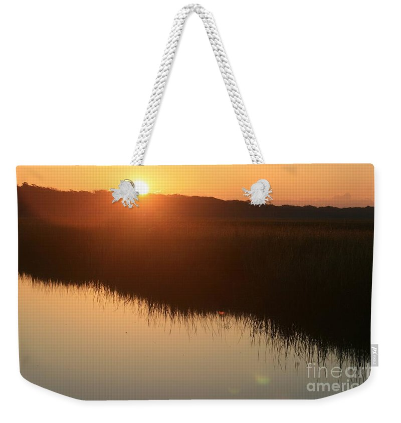 Sunrise Weekender Tote Bag featuring the photograph Autumn Sunrise Over The Marsh by Nadine Rippelmeyer