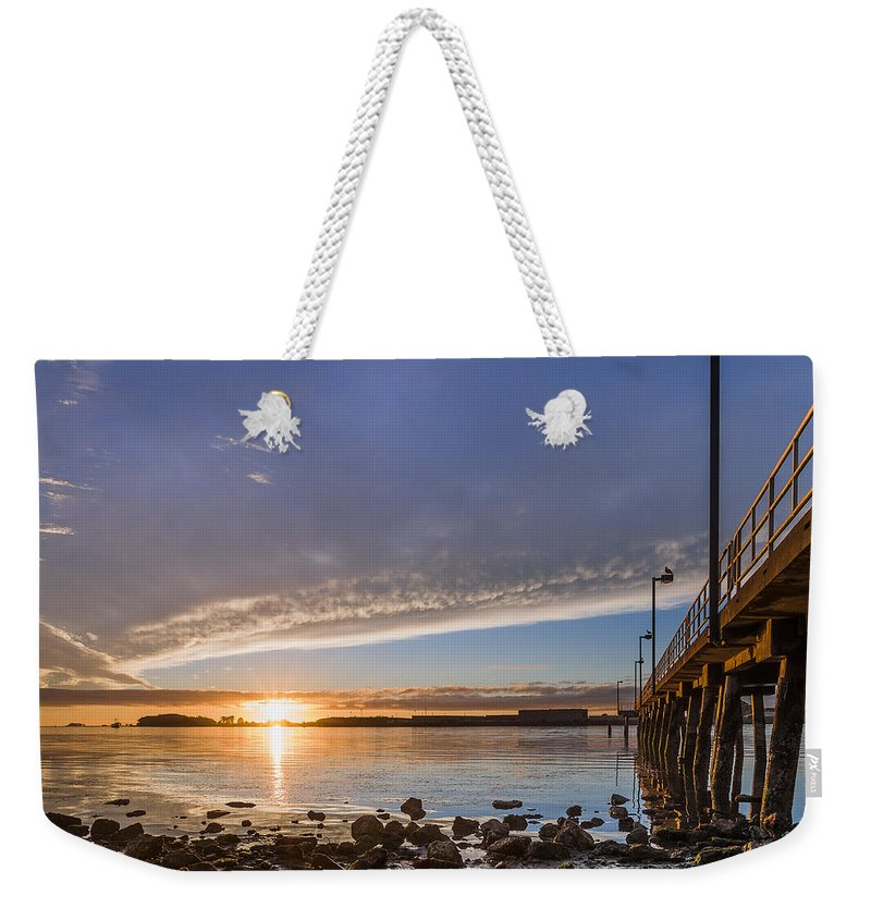 Humboldt Bay Weekender Tote Bag featuring the photograph Autumnal Sunset At Del Norte Pier by Greg Nyquist