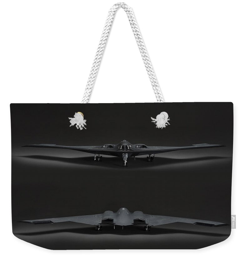 B-2 Stealth Bomber Weekender Tote Bag featuring the photograph B-2 Bomber by Robert Mollett
