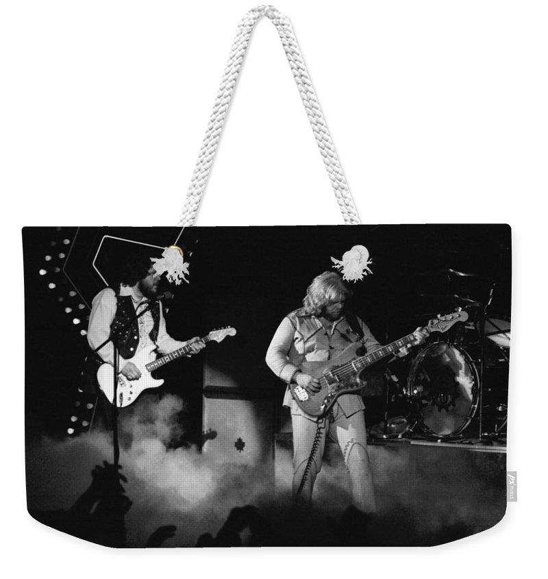 Bachman-turner Overdrive Weekender Tote Bag featuring the photograph Bachman-turner Overdrive Smokin In Spokane 1976 by Ben Upham