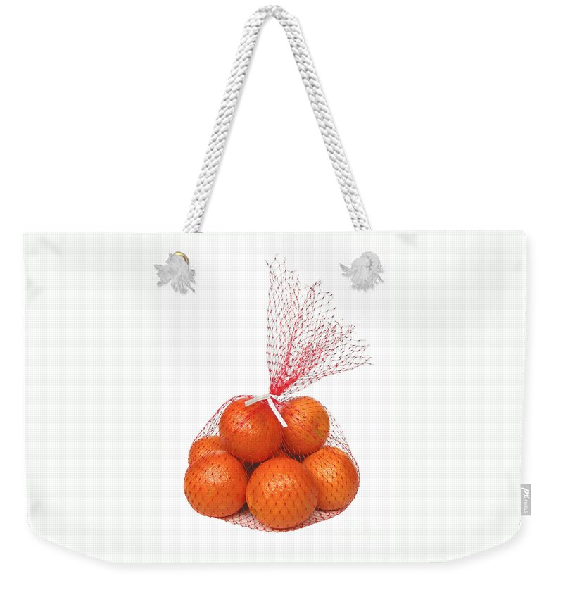 Oranges Weekender Tote Bag featuring the photograph Bag Of Oranges by Ann Horn