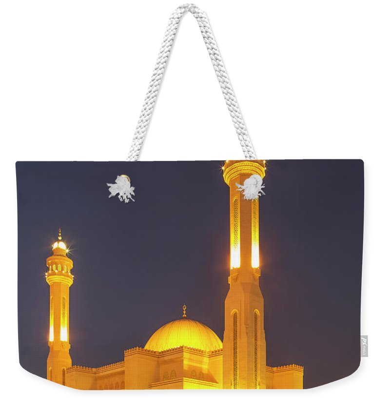 Tranquility Weekender Tote Bag featuring the photograph Bahrain. Manama. The Al Fateh Grand by Buena Vista Images