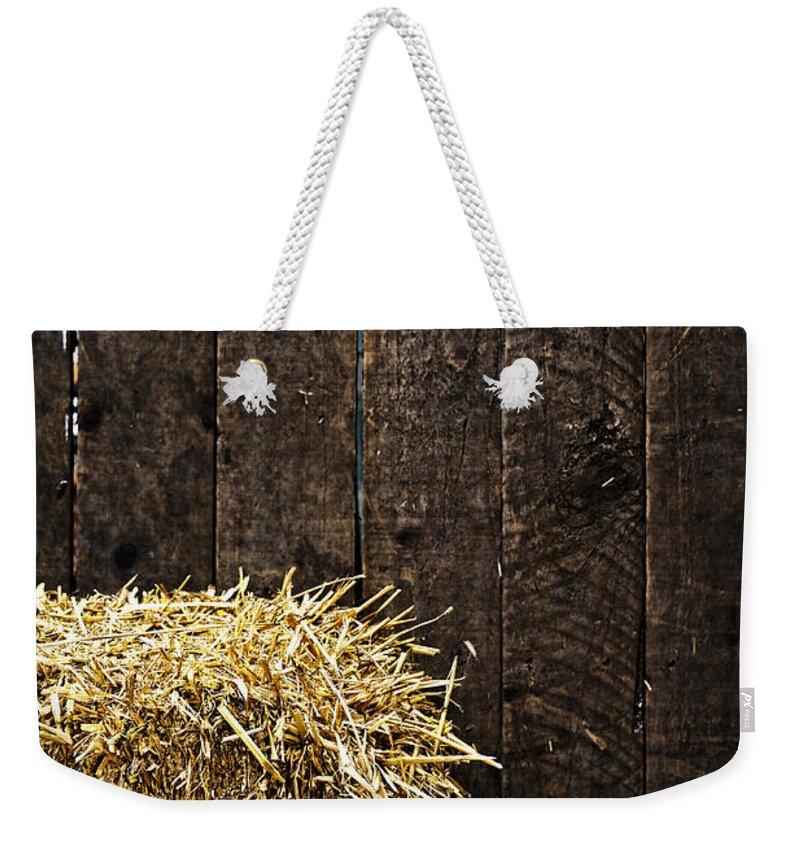 Straw Weekender Tote Bag featuring the photograph Bale Of Straw And Wooden Background by Dutourdumonde Photography