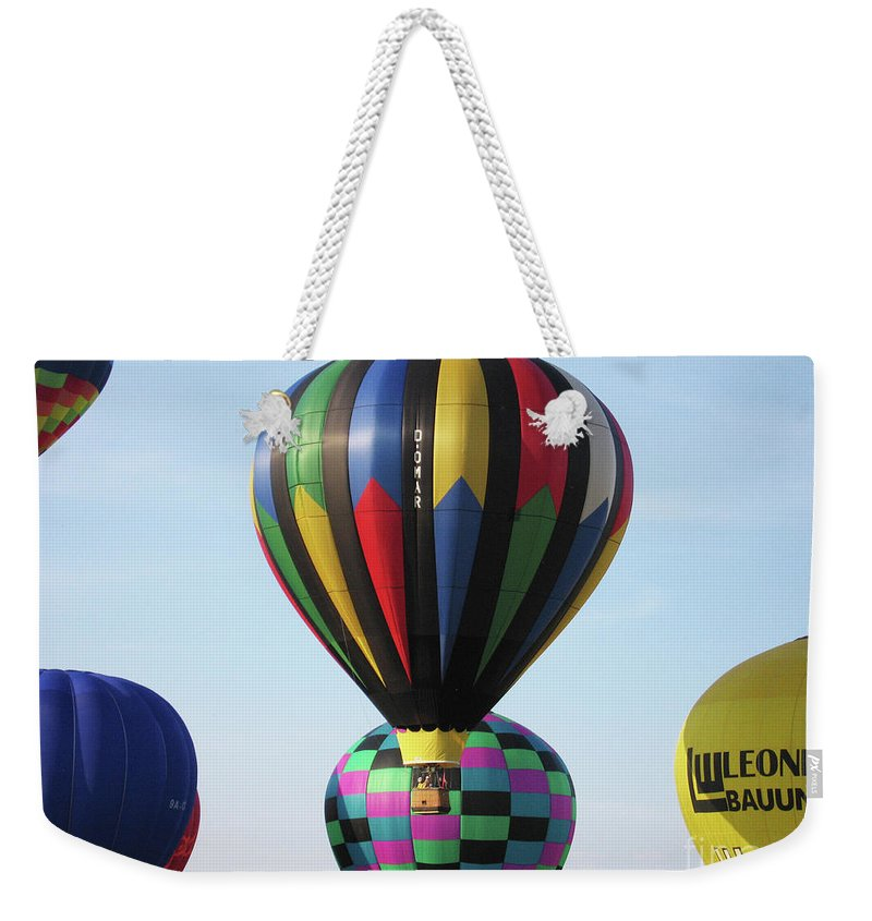 Balloons Weekender Tote Bag featuring the photograph Balloons by Ilaria Andreucci
