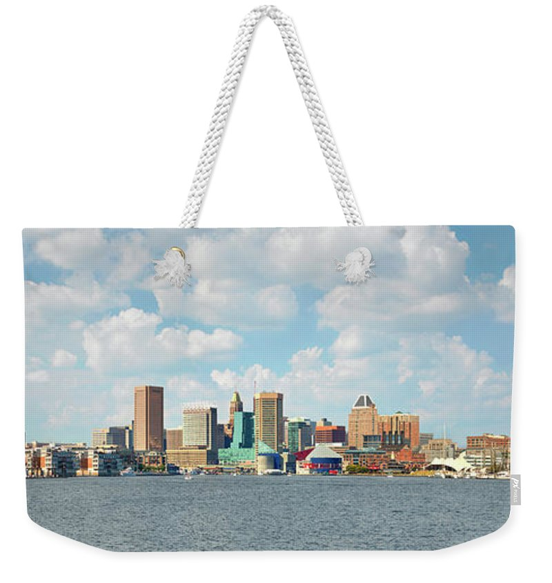 Downtown District Weekender Tote Bag featuring the photograph Baltimore Skyline And Inner Harbor by Greg Pease