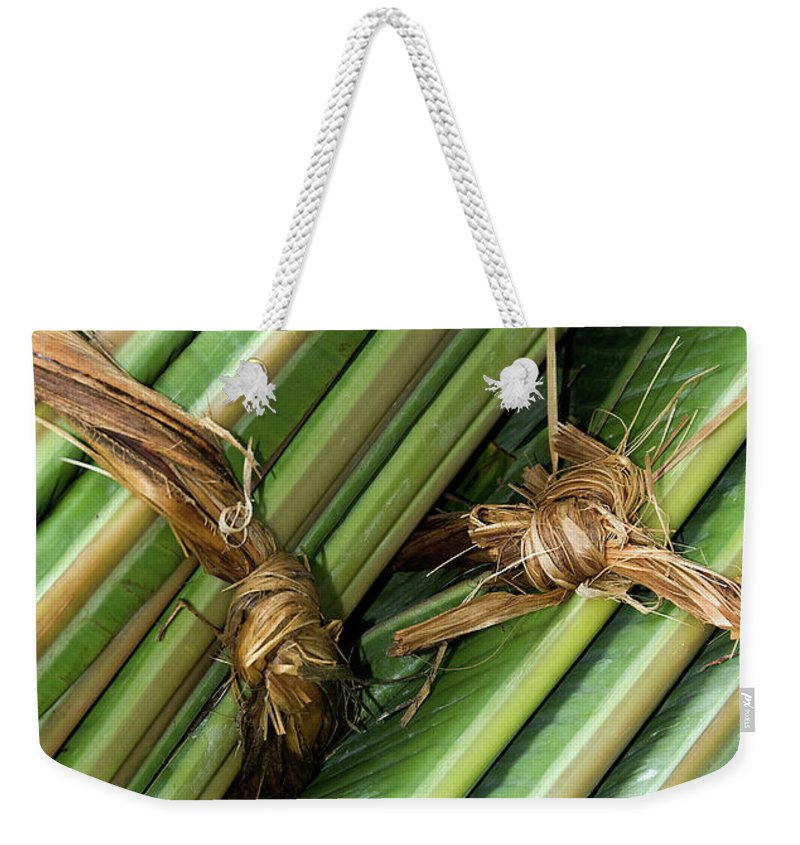 Roll Weekender Tote Bag featuring the photograph Banana Leaves by Rick Piper Photography