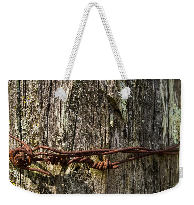 Barbed Weekender Tote Bag featuring the photograph Barbed Wire Rustic Twist by Douglas Barnett