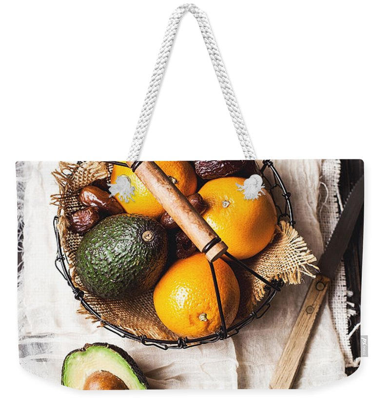 San Francisco Weekender Tote Bag featuring the photograph Basket With Avocado, Oranges And Dates by One Girl In The Kitchen