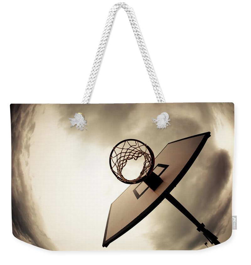Goal Weekender Tote Bag featuring the photograph Basketball Hoop, Dramatic Sky by Zodebala