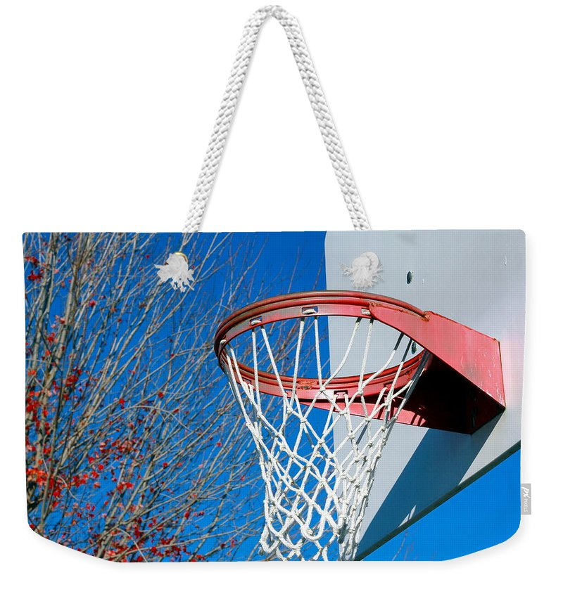 Net Weekender Tote Bag featuring the photograph Basketball Net by Valentino Visentini
