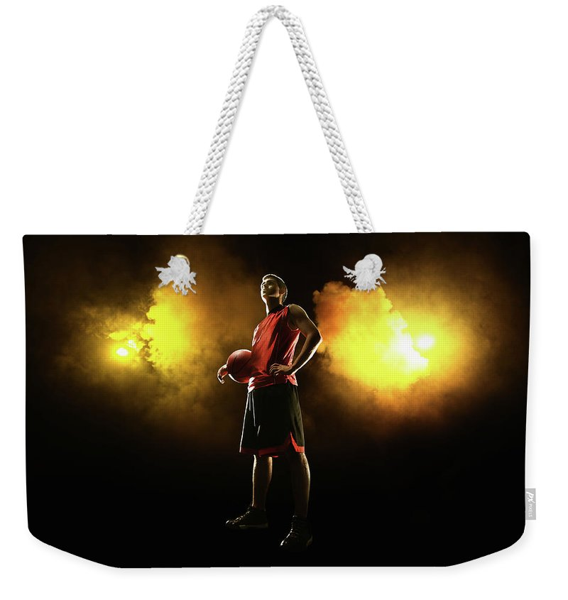 People Weekender Tote Bag featuring the photograph Basketball Player On Smoky Yellow by Stanislaw Pytel