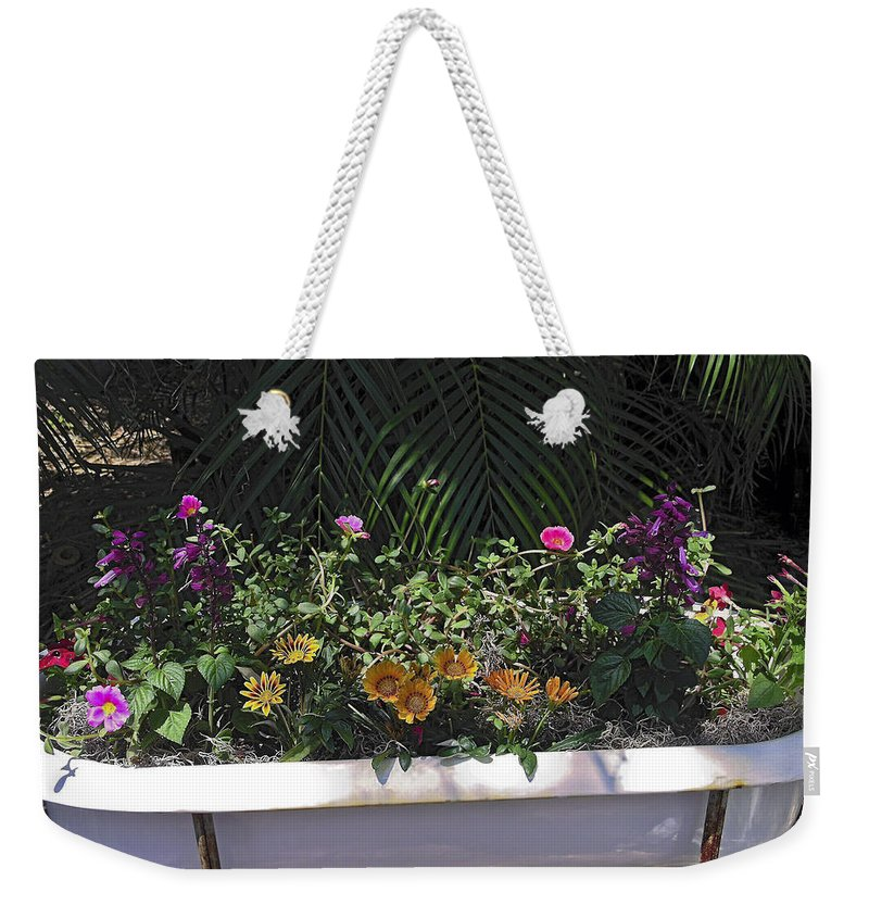 Mixed Flowers Weekender Tote Bag featuring the photograph Bath Tub Flowers by Sally Weigand