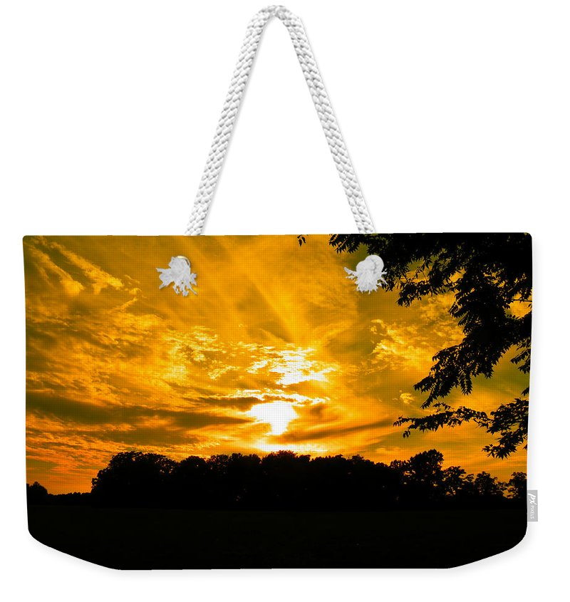 Sunset Weekender Tote Bag featuring the photograph Battle Of The Clouds by Nick Kirby