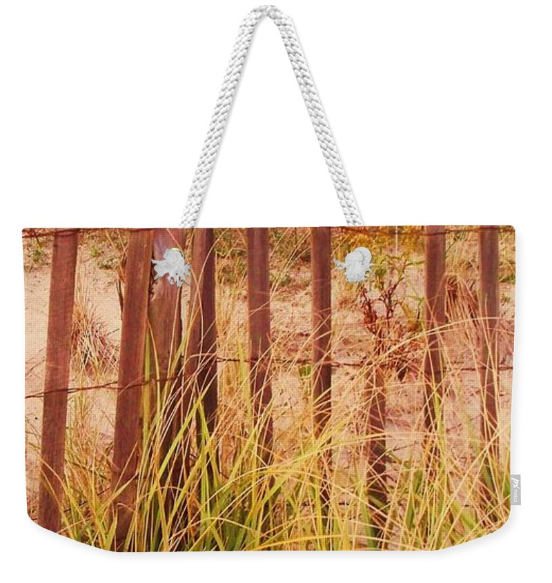 Beach Weekender Tote Bag featuring the photograph Beach Dune Fence At Cape May Nj by Eric Schiabor