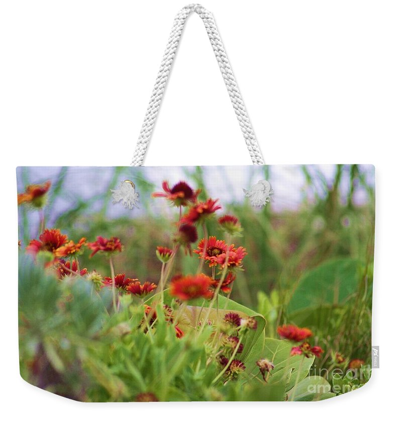 Beach Weekender Tote Bag featuring the photograph Beach Flowers by Chuck Hicks