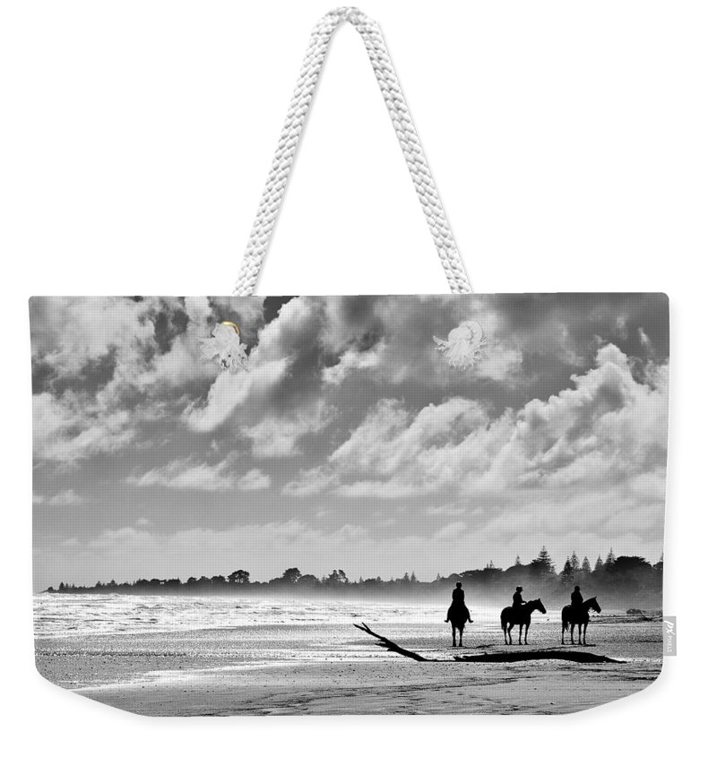 Ride Weekender Tote Bag featuring the photograph Beach Riders by Dave Bowman