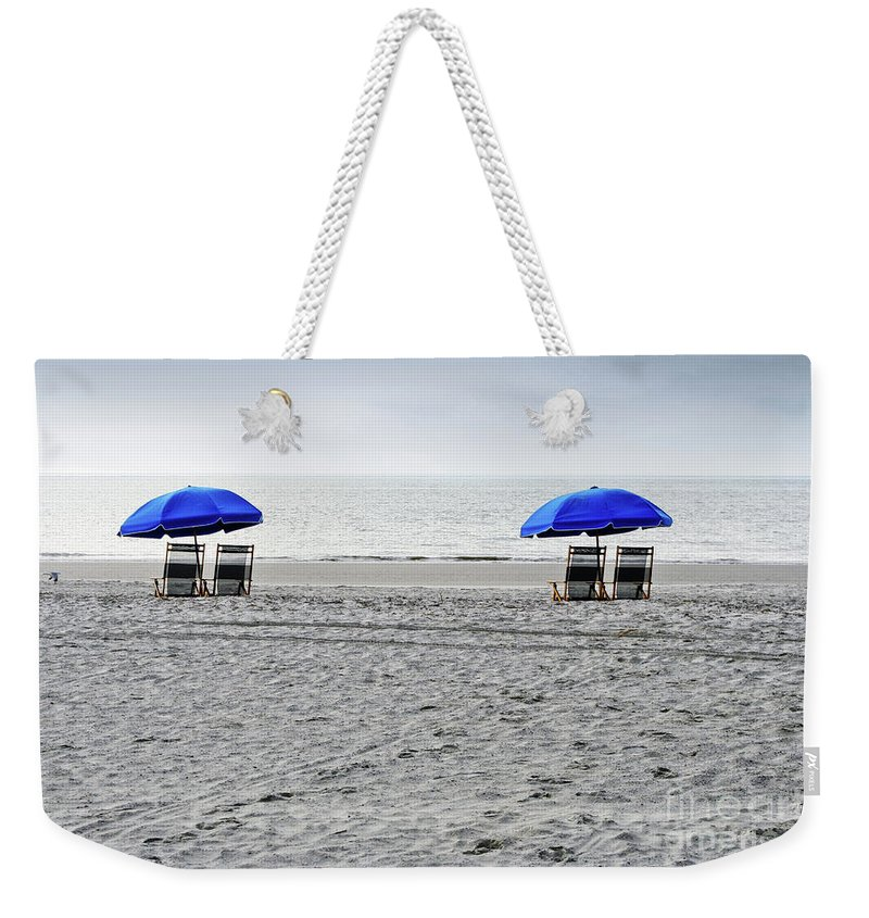 Hilton Head Weekender Tote Bag featuring the photograph Beach Umbrellas On A Cloudy Day by Thomas Marchessault