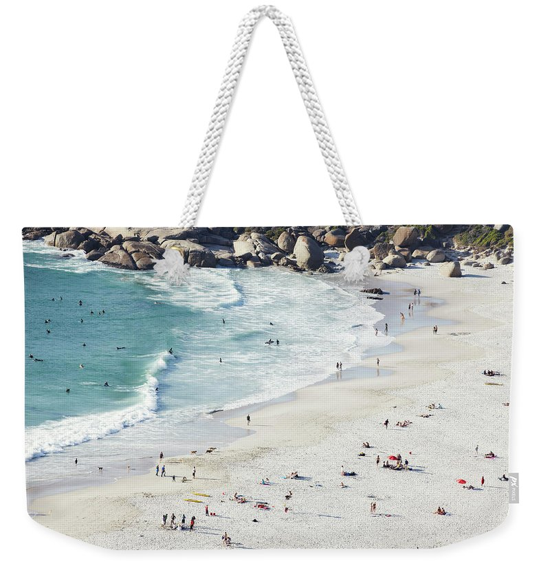 Sunbathing Weekender Tote Bag featuring the photograph Beach With Swimmers Cape Town by Michael Blann