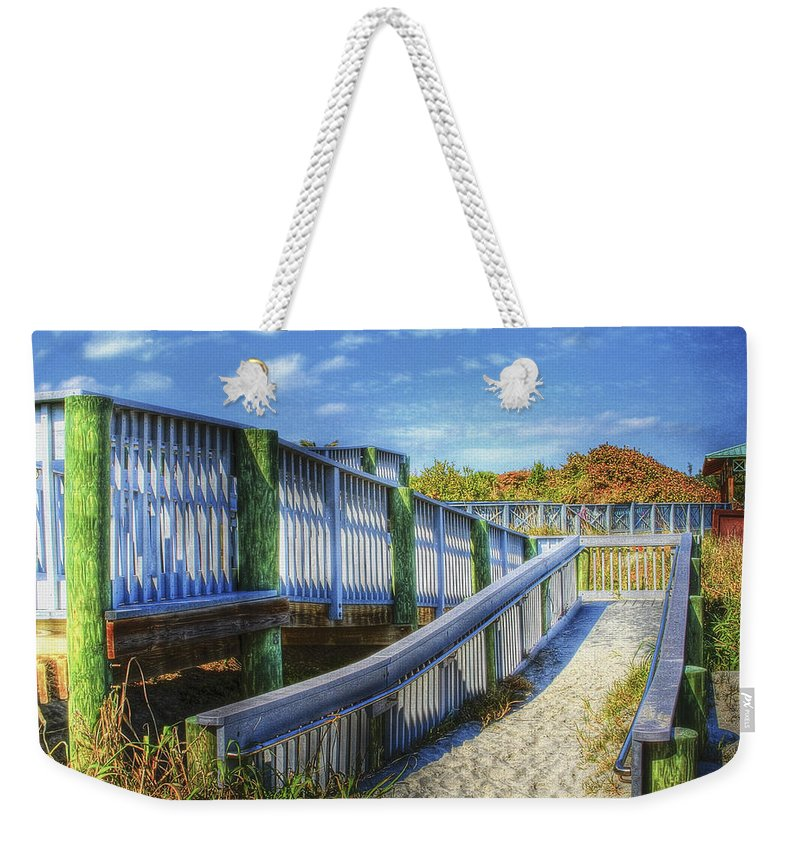 Clouds Weekender Tote Bag featuring the photograph Beachwalk by Debra and Dave Vanderlaan