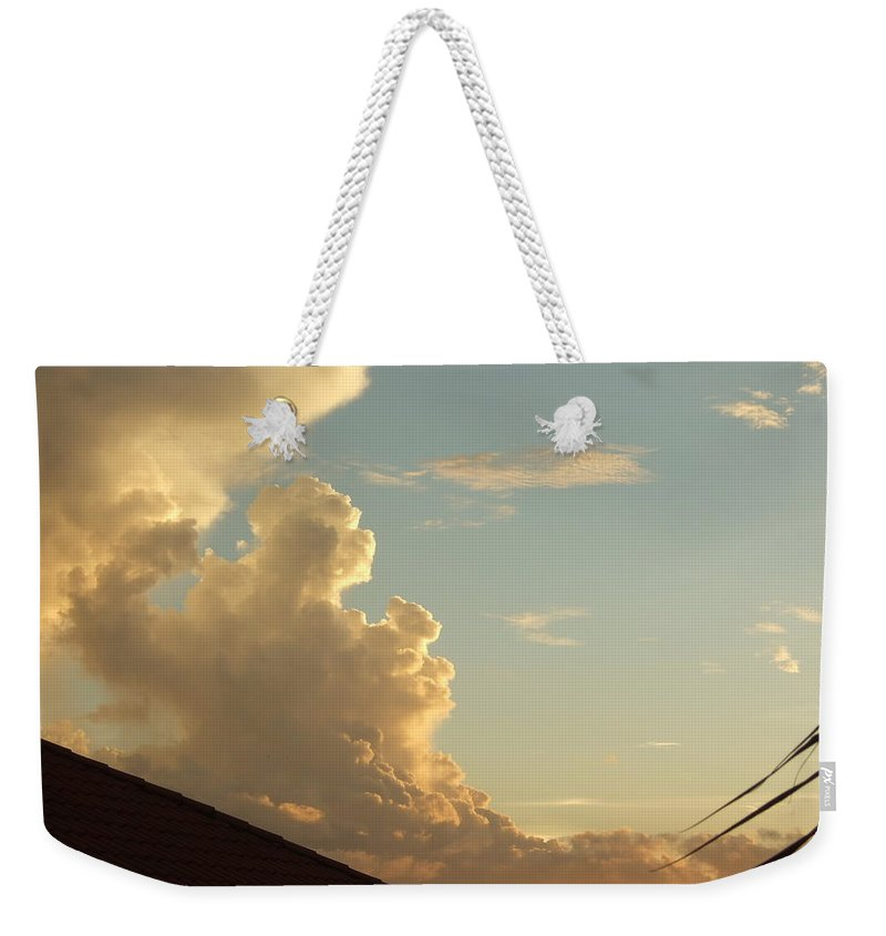 Weekender Tote Bag featuring the photograph Bear Cloud by Katerina Naumenko
